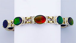Custom ammolite bracelet set in gold